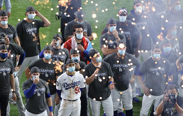 The Los Angeles Dodgers react during the Commissioner's Trophy...