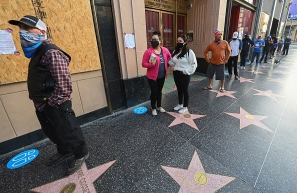Voters line up as they wait for the Pantages Theatre polling station to open