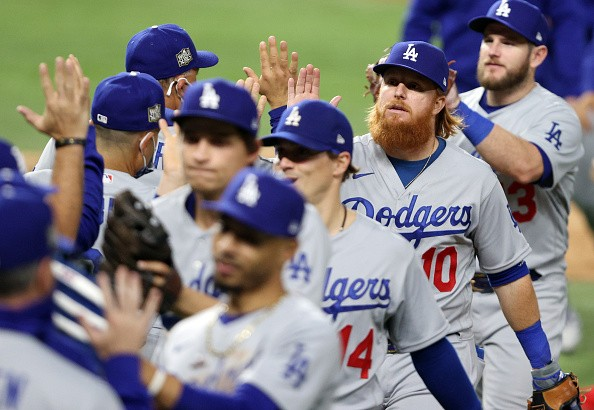 Justin Turner of the Los Angeles Dodgers celebrates with teammates...