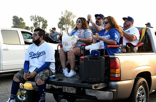 Fans look on a giant screen during game one of the World Series...