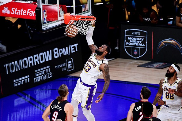 LeBron James of the Los Angeles Lakers dunks the ball during the...