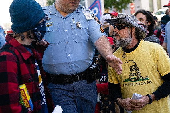 A Georgia State Trooper separates Biden supporters from Trump supporters