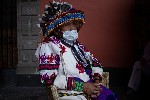 A person wearing a typical costume from the Tatei Kie people of...