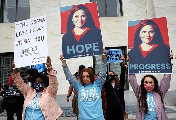 Supporters of Supreme Court nominee Judge Amy Coney Barrett...