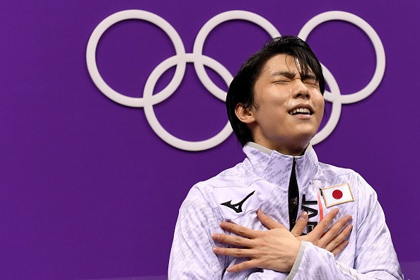 Yuzuru Hanyu of Japan reacts after competing during the Men's Single...