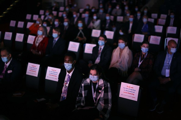 Audience members watch the final presidential debate with U.S....