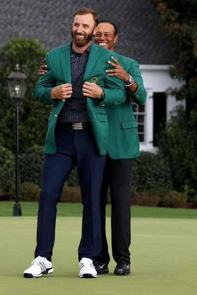 Dustin Johnson of the United States is awarded the Green Jacket by...
