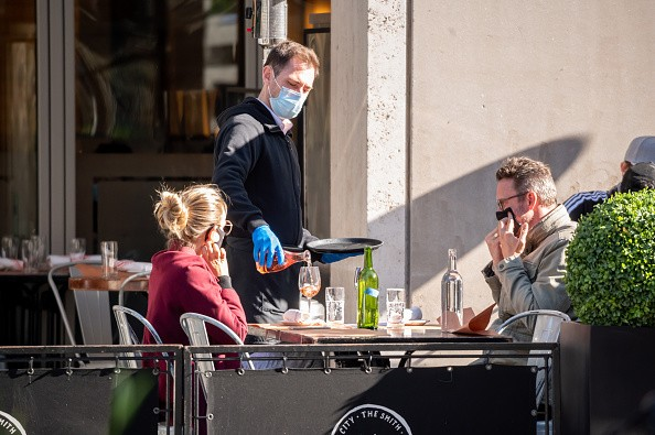 People wear face masks at The Smith restaurant on the Upper West Side...