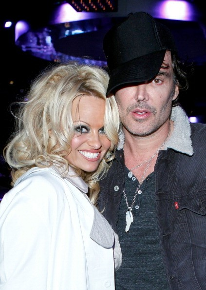 Actress Pamela Anderson and Photographer David LaChapelle attend 2011...