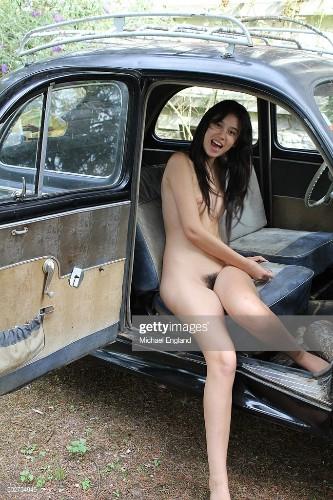 young pretty eurasian girl woman enjoys nudist naturist naked life at...