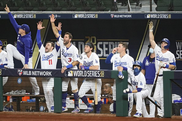 The Los Angeles Dodgers celebrate a runs scored by Mookie Betts...