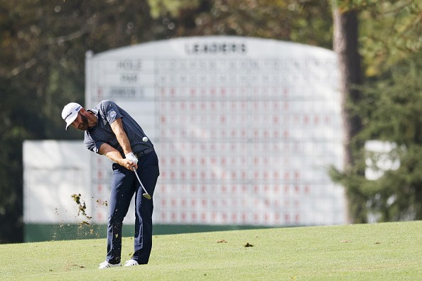 Dustin Johnson of the United States plays a shot on the 14th hole...
