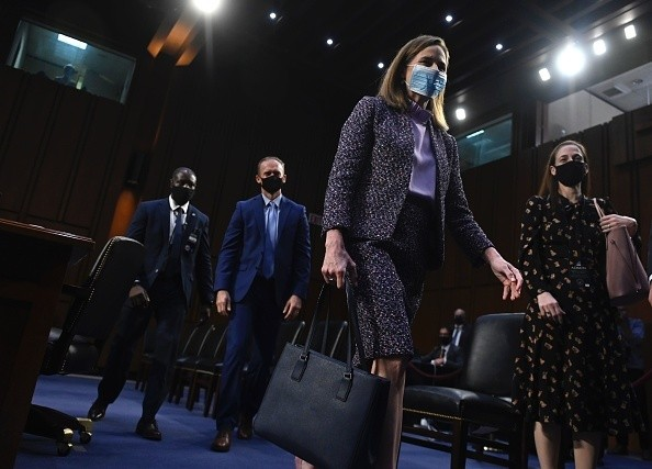 Supreme Court nominee Judge Amy Coney Barrett leaves after testifying...