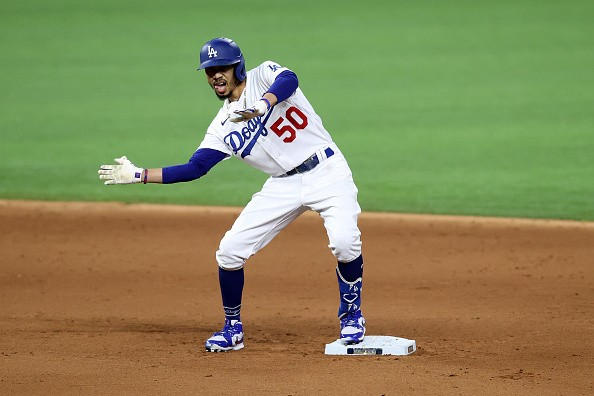 Mookie Betts of the Los Angeles Dodgers celebrates after hitting a...
