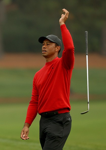 Tiger Woods of the United States reacts to a shot on the second hole...