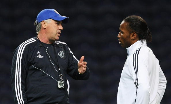 Manager Carlo Ancelotti speaks to Didier Drogba during the Chelsea...