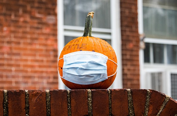 A pumpkin with a face mask is seen at Governors Island's annual...