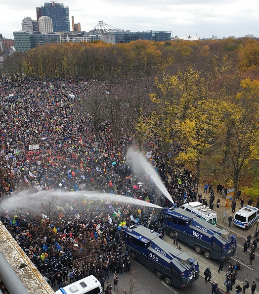 Police are using water cannons at a demonstration against the federal...
