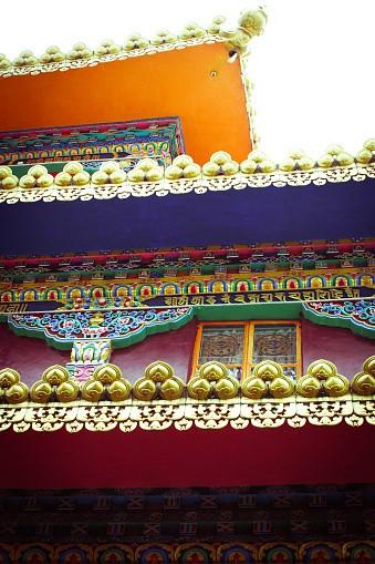 The exterior of stunning Tibetan Buddhist temple. Kalachakra Temple,...
