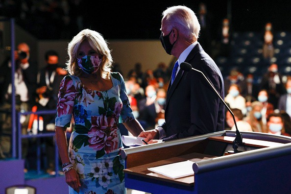 Democratic presidential nominee Joe Biden is joined onstage by wife...
