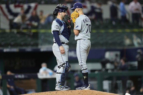 Mike Zunino and Nick Anderson of the Tampa Bay Rays meet on the mound...