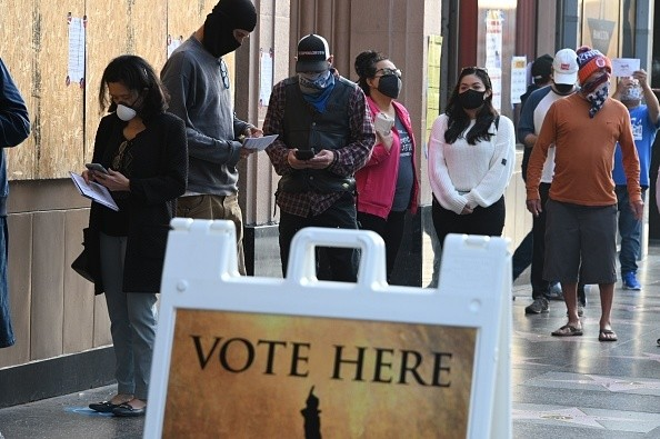 At the Pantages Theater in LA, people wait in line for the vote center to open