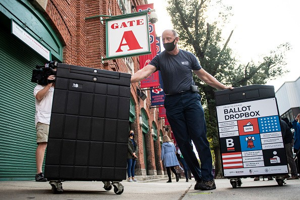 Ballot dropboxes and voting materials are unloaded as the ballpark is...