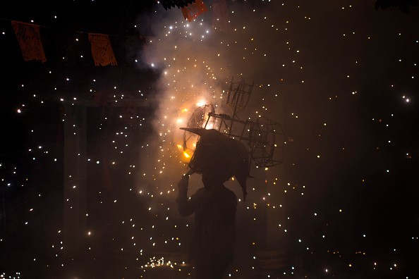 People take part in the celebration for the Day of The Dead in the...