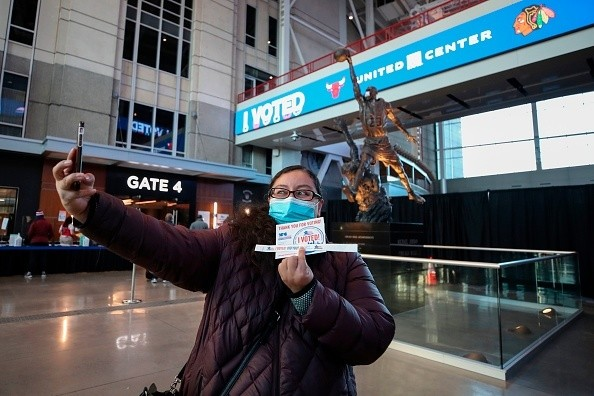 Chicago, Illinois, Gina Barba takes a selfie after casting her ballot
