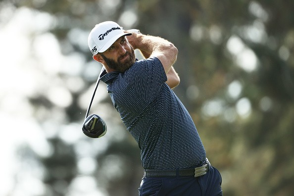 Dustin Johnson of the United States plays his shot from the third tee...