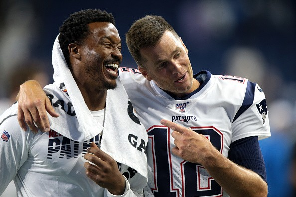 New England Patriots WR Demaryius Thomas talks with QB Tom Brady as...