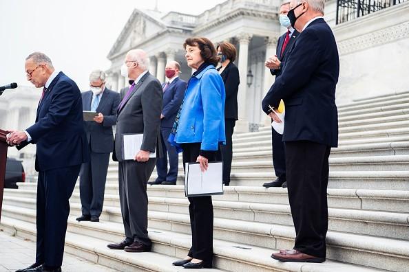 From left, Senate Minority Leader Charles Schumer, D-N.Y., Sens....
