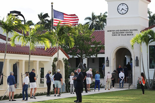 Palm Beach, Florida, where the First Lady voted, people stand in line to vote
