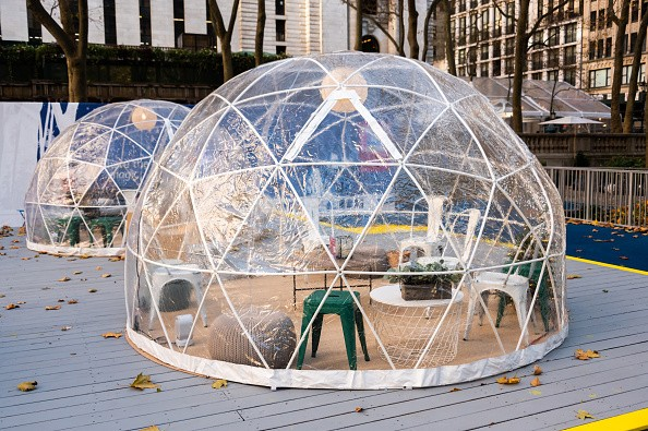 Igloo dining tents are set up at the Bank of America Winter Village...