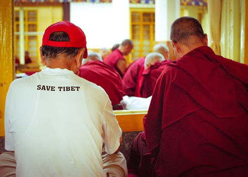 Tibetan Buddhist monks offering morning prayer at the Dalai Lama...