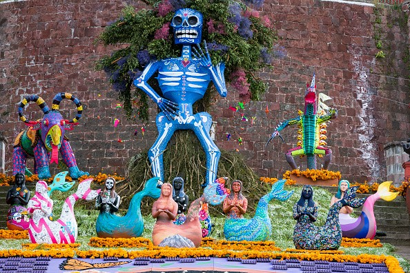 """A giant skeleton and decorative """"tlanchanas"""" sculptures are placed in..."""