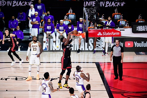 Bam Adebayo of the Miami Heat dunks the ball during the fourth...