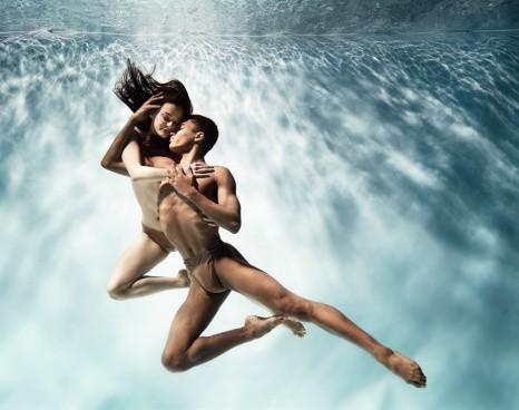 Ballet dancers performing under water.