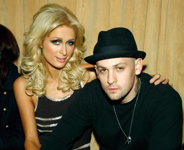 Paris Hilton and Good Charlotte guitarist Benji Madden appear at the...