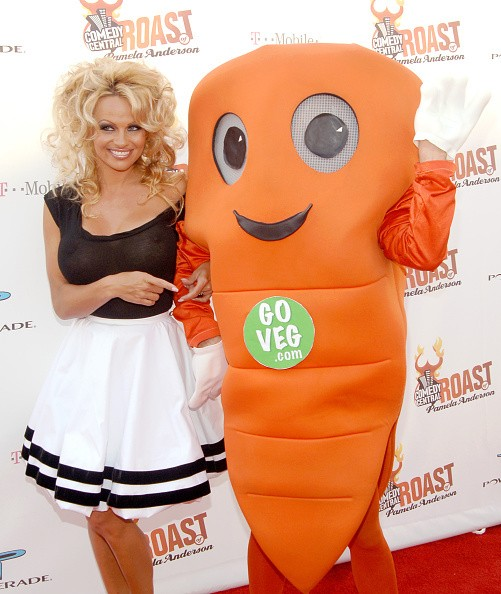 Pamela Anderson with Chris P. Carrot, PETA mascot during Comedy...