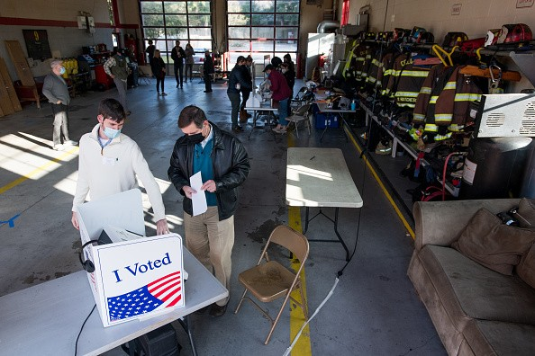 A poll worker helps a voter in Columbia, South Carolina
