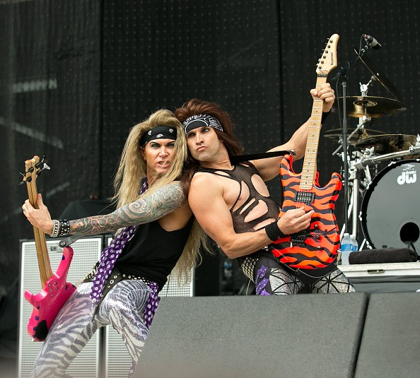 Lexxi Foxx and Satchel of Steel Panther performs onstage during 2013...
