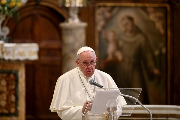 Pope Francis holds his speech during an International Prayer Meeting...