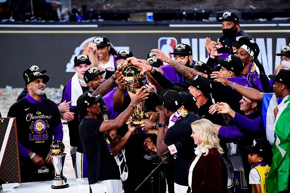 The Los Angeles Lakers celebrate with the trophy after winning the...