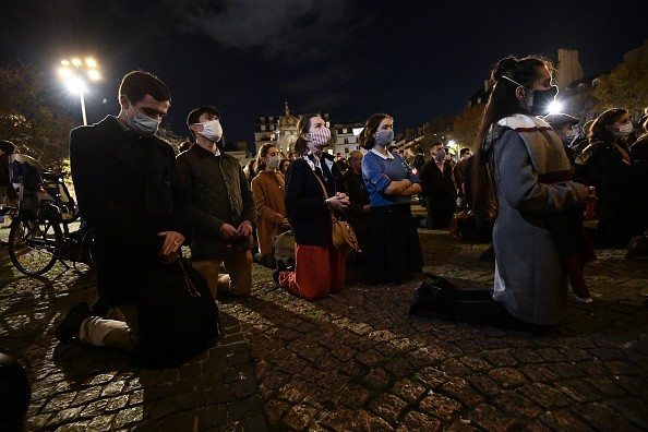 Catholics gathered outside Saint Sulpice Church to protest by singing...