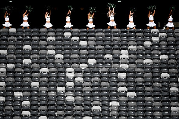 New York Jets Flight Crew cheerleaders perform from the concourse in...