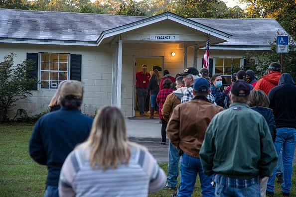 In Florida, voters stand in line at dawn as the polls open on November 3