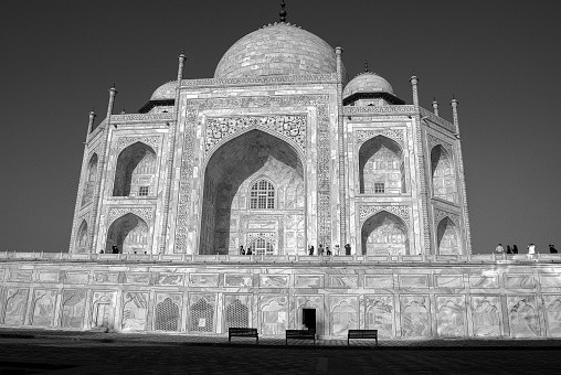The Taj Mahal is an ivory-white marble mausoleum on the south bank of...