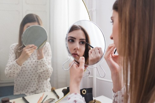 Why More Makeup Means Better Pay for Women