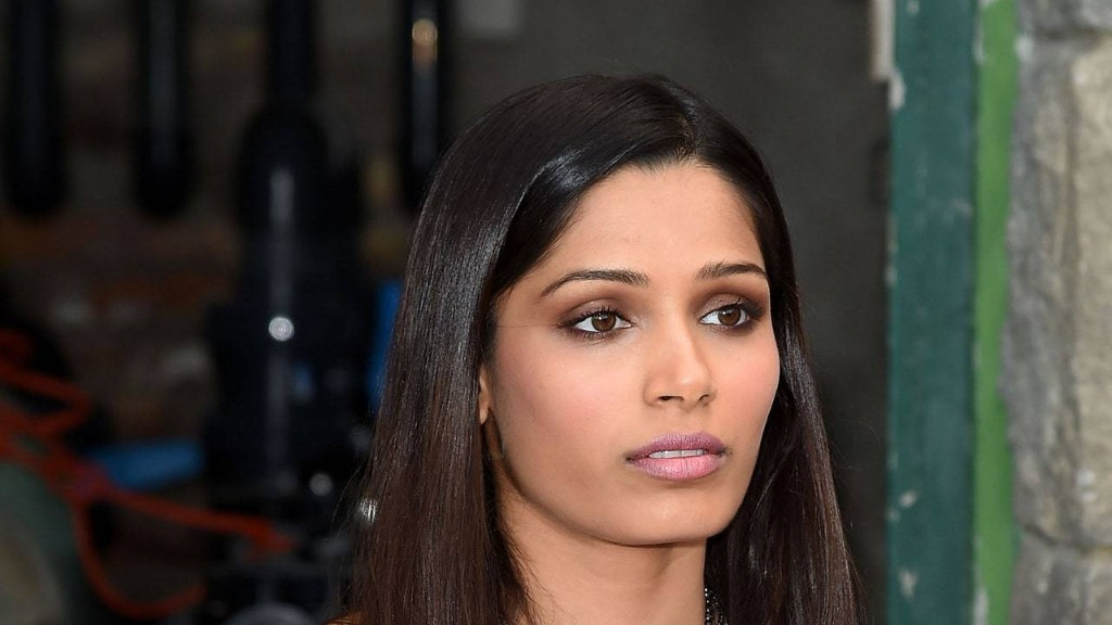 Here's Freida Pinto, Making Me Want to Whip Out My Straightening Iron Like It's 1997